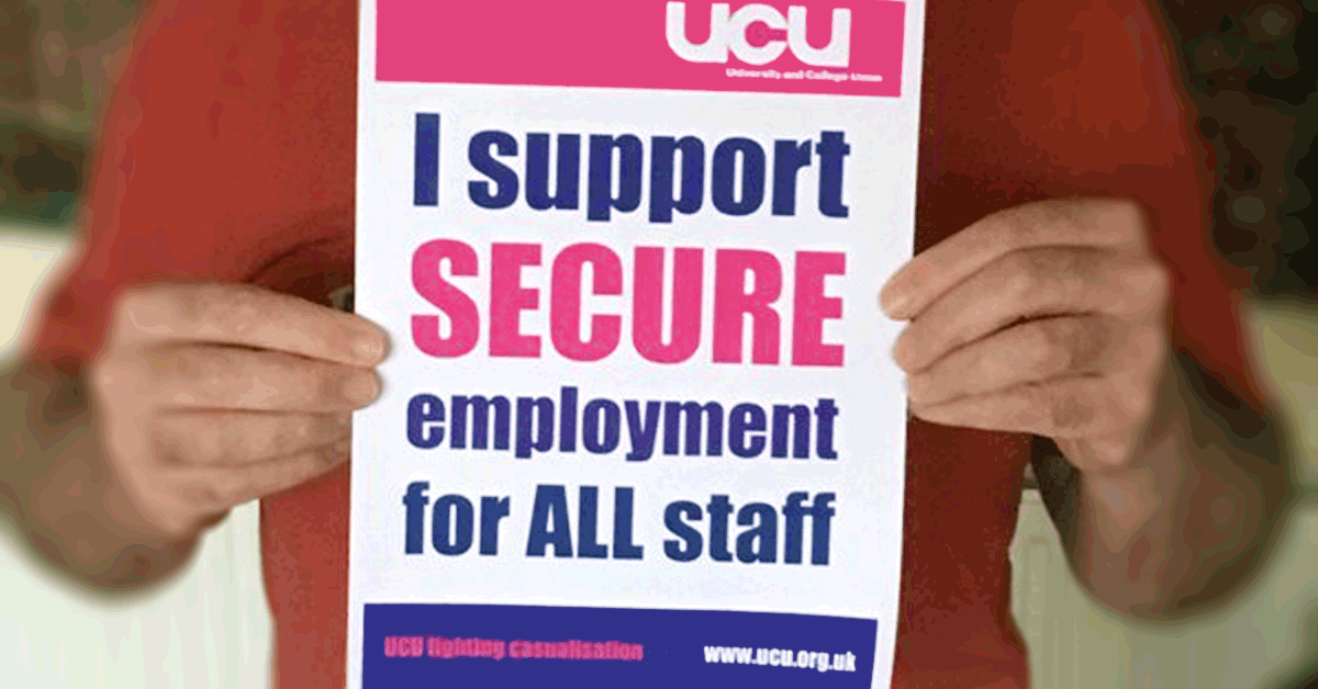 Members holding an 'I support secure employment for all staff' poster